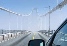 Hazy bridge over fjord Stock Images