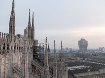 Hazy Cityscape seen from Milan Cathedral. Overview of Hazy Cityscape and Torre Velasca from Rooftop of Historic Milan Cathedral, a Popular Tourist Destination Stock Photos