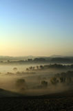 Hazy country. Morning mist in country with blue sky Stock Images