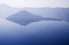 Hazy Crater Lake Island Stock Photo