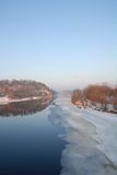 Hazy day on the Chippewa River. Ice begins to melt on a cold spring day on the Chippewa River in Eau Claire, Wisconsin stock photography