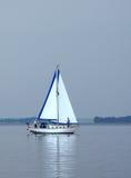 Hazy Day Sail. Sailboat on the lake on a hazy day stock image