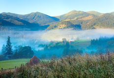 Hazy daybreak in mountain valley Royalty Free Stock Photography
