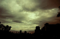 Hazy gloom skies. A yellow-green cloudy sky over some of Chicago's silhouetted buildings royalty free stock photo