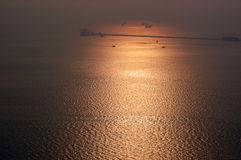 Hazy golden sunset on Arabian sea Stock Image