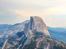 Hazy Half Dome and Mountains. Hazy looking day at Yosemite National Park in the Springtime royalty free stock photography