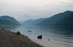Hazy lake. Between mountains in the summer morning Royalty Free Stock Photography