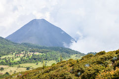 The hazy landscape with peak of Izalco volcano, El Salvador Stock Image