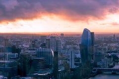 Hazy menacing sky above London cityscape at sunset