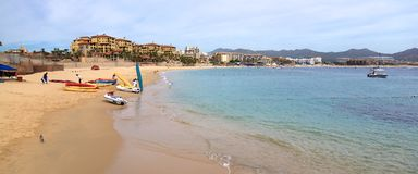 Hazy morning at Medano Beach. Medano beach on a hot mid morning. People are setting up their marine rentals for the day. Cabo San Lucas, Mexico Royalty Free Stock Images