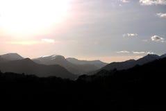 Hazy mountain range Stock Images