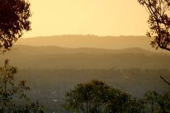 Hazy mountain sunset. Looking to hinterland Stock Photo