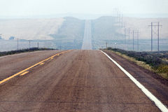 Hazy road. A hazy, hilly road in North Dakota Stock Image