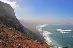 Hazy, rough and rocky coast of spanish volcanic island lanzarote Royalty Free Stock Images