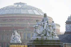 Hazy Royal Albert Hall. Albert Memorial statue overlooking hazy Royal Albert Hall, in London. The concert hall is home to the Proms, which take place each summer Royalty Free Stock Photos