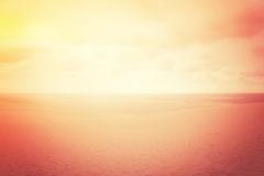 Hazy sand dunes in red glow Stock Photo