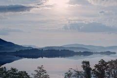 Hazy Sunrise in mountain lake Stock Images