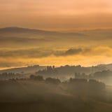 Hazy Sunrise over tuscan Hills Stock Image