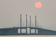 Hazy Sunrise and Sunset in Penang Bridge George Town, Penang Malaysia Royalty Free Stock Photo