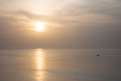 Hazy Sunset and boat Royalty Free Stock Images