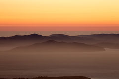 Hazy sunset over Angel Island and the Marin Hills of the Golden-Gate National Recreation Area. Royalty Free Stock Photography