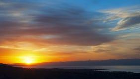 Hazy sunset over Issyk Kul lake Stock Images