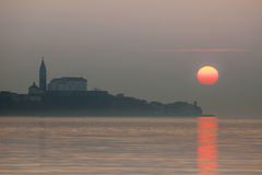 Hazy sunset over Piran, Slovenia. Silhouette of the town Piran with cathedral in hazy summer afternoon Royalty Free Stock Photo