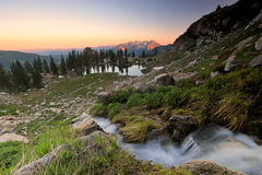 Hazy sunset in the Wasatch Mountains. Hazy sunset clouds at Silver Lake, Utah, USA Royalty Free Stock Images