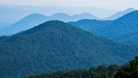 Hazy view of the Blue Ridge Mountains, Virginia, USA. Hazy view of the Blue Ridge Mountains from an overlook on the Blue Ridge Parkway located in Bedford County royalty free stock image
