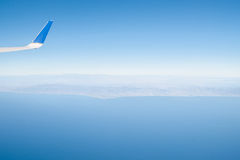 Hazy view of Californian coast from plane leaving Los Angeles. Royalty Free Stock Image