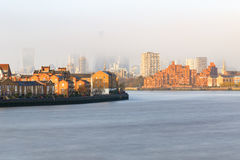Hazy view of City of London. Seen from Canary Wharf stock images