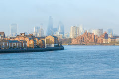 Hazy view of City of London. Seen from Canary Wharf royalty free stock photography