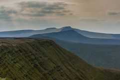 View over mountains and ridges. Hazy view of mountain plateaus and ridges. The highest peaks in Brecon Beacons, Wales royalty free stock photography