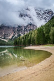 Hazy view of Pragser Wildsee in Dolomites Royalty Free Stock Image