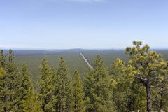 Hazy view of route 97 North from Lava Butte OR. Royalty Free Stock Images