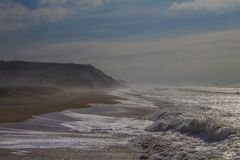 Hazy weather and a stormy ocean Stock Images