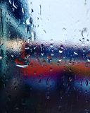 Hazy window in April showers. Hazy window monsoon rain raindrop raindrops showers april rainy water reflection colors abstract stock images