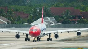 HB-JMG - Edelweiss Airbus A340-300 taxis on airfield at Phuket International Airport. PHUKET, THAILAND - DECEMBER 5, 2016: Edelweiss Airbus A340-300 HB-JMG taxis stock video footage