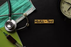 HbA1c - Test text on top view black table with blood sample and Healthcare/medical concept stock photo