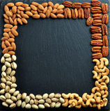 HBackground of nuts - cashews, pistachios, almonds and pecans. Stock Photos