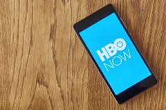 HBO Now application on smartphone on table royalty free stock photo