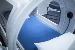 HBOT Hyperbaric Oxygen Therapy treatment chamber. Hyperbaric Oxygen Therapy (HBOT) chamber tank used for specialised medical treatment for injuries in hospital royalty free stock image