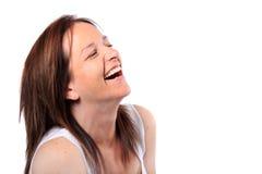 Hübsche Frau in ihrem Vierzigerlachen Stockbilder