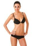 Hübsche gebräunte Frau im Bikini Stockbilder