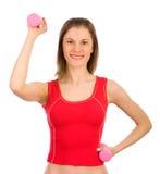Hübsches Mädchen, das Sport tut. Getrennt auf Weiß. Stockbild
