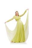 Hübsches Mädchen im eleganten grünen Kleid lokalisiert auf Lizenzfreies Stockbild