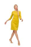 Hübsches Mädchen im gelben Kleid lokalisiert auf dem Weiß Stockbild