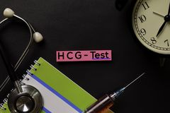 HCG - Test on top view on top view black table with blood sample and Healthcare/medical concept stock photography