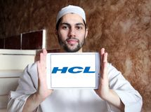 HCL Technologies logo. Logo of HCL Technologies on samsung tablet holded by arab muslim man. HCL Technologies Limited is an Indian multinational IT services Royalty Free Stock Images