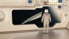 An astronaut on a spaceship watching the saturn